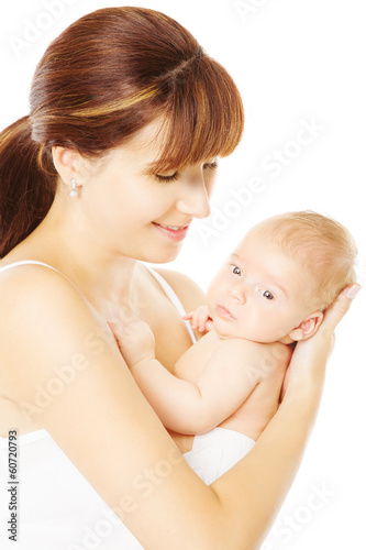 Mother holding newborn baby in hand, white background