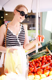 Young woman shopping for fresh tomatoes