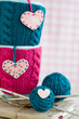 Two blue cups in blue and pink sweater with felt hearts