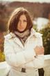 Outdoor fashion portrait of young beautiful woman. Woman posing