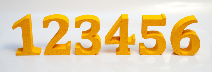 Пенопластовые цифры на белом фоне
