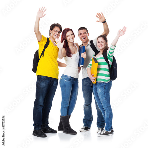 Four Students smiling and hand wave