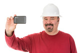 Smiling workman taking a self-portrait