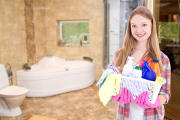 housewife with cleaning supplies in bathroom