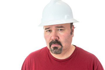 Thoughtful man wearing a hardhat