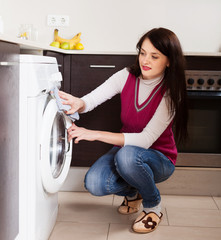woman cleaning washing machine
