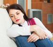 Depressed  woman on sofa