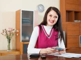 happy woman with money and documents