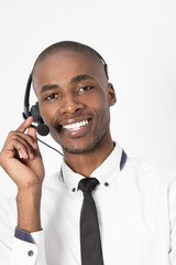 Young professional call center agent male talking