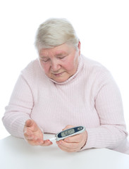 Diabetes senior woman measuring glucose level blood test