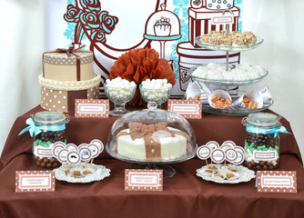 Fancy set table with sweets candies, cake, marshmallows, zephyr,