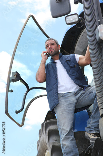 farmer on his tractor talking on the phone