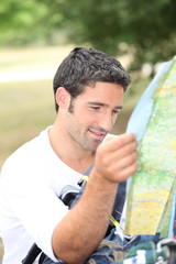 Man looking at map for directions