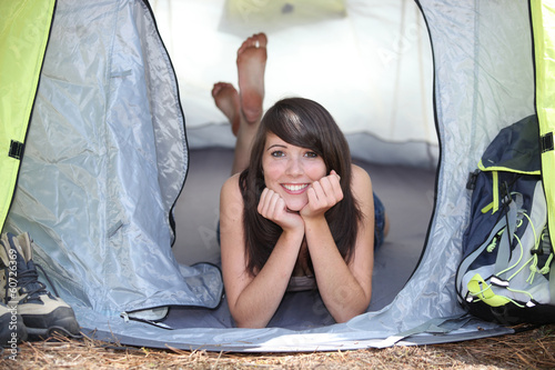 girl resting in a canvas tent