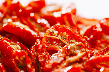 sun-dried tomatoes with olive oil, background, shallow dof
