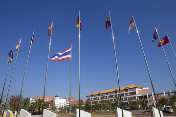 Thailand flag waving atop flagpole surrounded by ASIAN contry fl