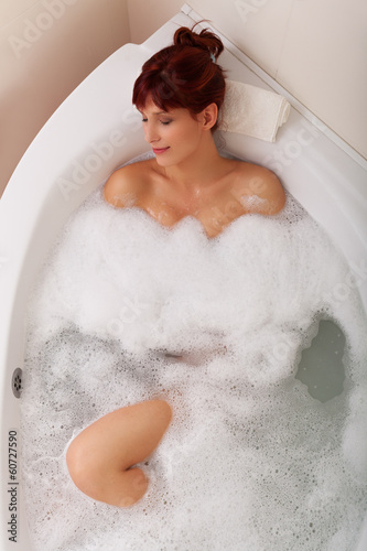 Women relaxing in a bathtube