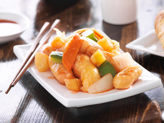 chinese sweet and sour chicken with chopsticks