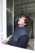 Man hanging a window