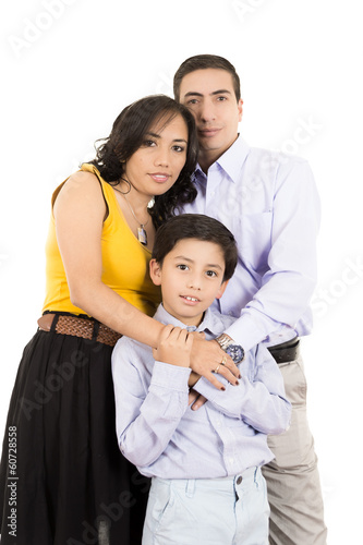 Hispanic family close together holding