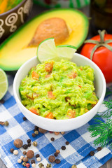 Guacamole with avocado, lime, tomato