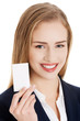 Beautiful caucasian business woman holding personal card.
