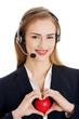 Beautiful caucasian business woman at call center holding heart.