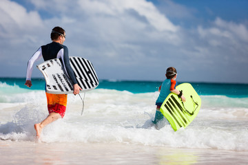 Father and son with boogie boards