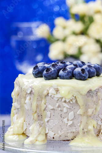 White chocolate cake decorated with blueberries. Bouquet