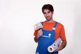 Man holding wallpaper