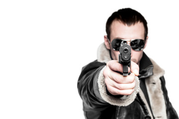 Man with gun in sunglasses. Isolated on white background.