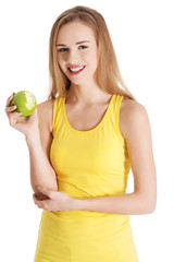 Beautiful causal caucasian woman holding fresh green apple with