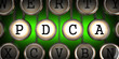 Old Typewriter's Keys with PDCA Slogan. - 60730567