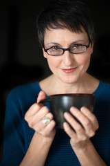 Beautiful Woman with Short Hair and Coffee Cup on Black Backgrou