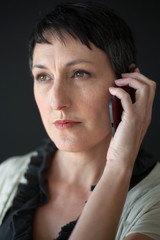 Beautiful Woman with Short Brown Hair Talking on a Cell Phone