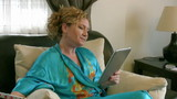 Woman using digital tablet and receiving good news