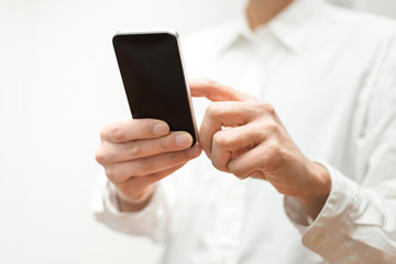 Closeup image of man using a mobile smartphone