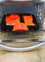 Wild Salmon being Place into Oven