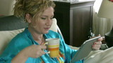 Woman using digital tablet computer PC and drinking coffee