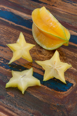 Carambola  and slices on table. Vertical