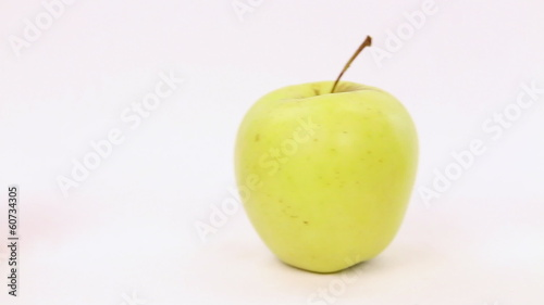 Line of green apples with one red apple, be different