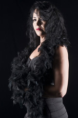 Sensual erotic woman in black with feathers