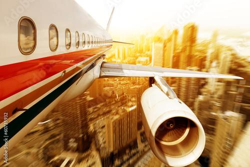 Fototapeta Aircraft above city