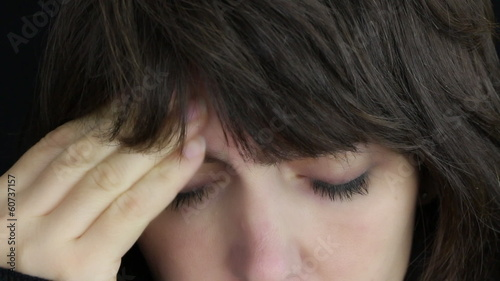 Woman having headache, close up