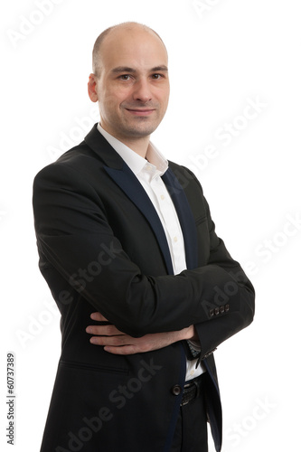 smiling businessman with his arms folded