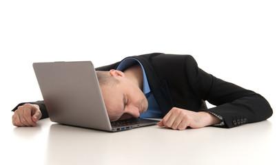 stressed businessman sleeping on a laptop