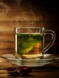 Glass cup with peppermint tea against wooden background