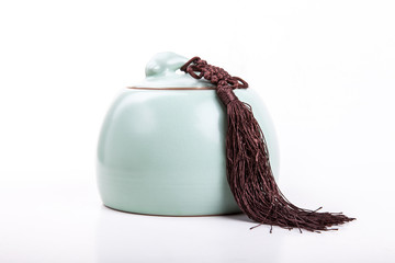 Vintage or antique light green tea canister with tassel isolated