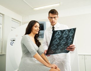 Doctor with young woman patient