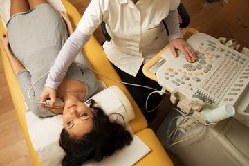 Young woman doing neck ultrasound examination at hospital
